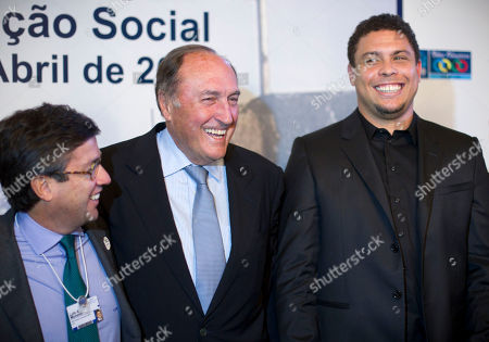 Stock Image of Luis Alberto Moreno, Ramon Pont, Ronaldo Luis Alberto Moreno, president of the Inter-American Development Bank, IBD, left, Ramon Pont, vice president of the Barcelona futbol club foundation and Brazilian former soccer player Ronaldo laugh during a launching event in Rio de Janeiro, Brazil, . FC Barcelona and the Inter-American Development Bank, IBD, launched a sports' social project for underprivileged children in partnership with the U.S. National Basketball Association, company of advertising and marketing WPP and the city of Rio de Janeiro
