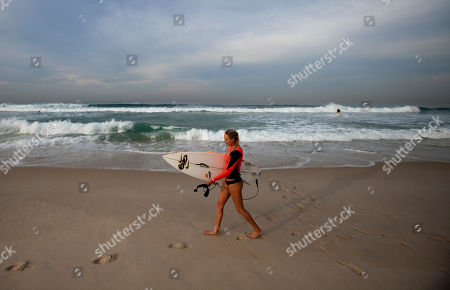 Laura Enever Laura Enever, of Australia, walks along Barra da Tijuca beach before the start of the women's Billabong Rio Pro surfing championship in Rio de Janeiro, Brazil