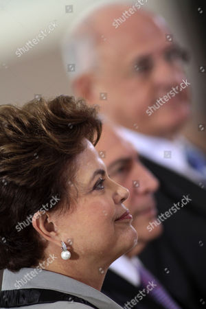 Dilma Rousseff, Michel Temer, Nelson Jobim Brazil's President Dilma Rousseff, left, Vice President Michel Temer, center, and Defense Minister Nelson Jobim, attend a military promotion ceremony at the Planalto Palace in Brasilia, Brazil