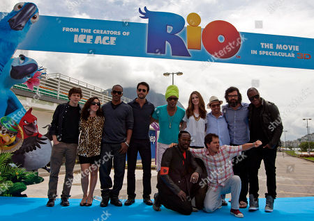 "Jesse Eisenberg, Bebel Gilberto, Jamie Foxx, Rodrigo Santoro, Carlinhos Brown, Anne Hathaway, Sergio Mendes, Jemaine Clement and Taio Cruz, Will.i.am, Carlos Saldanha Members of the ""Rio, the movie"" movie team pose for pictures after a press conference in Rio de Janeiro, Brazil, . Top row, from left, actor Jesse Eisenberg, from U.S., singer Bebel Gilberto, from U.S., actor and singer Jamie Foxx, from U.S., actor Rodrigo Santoro, from Brazil, singer Carlinhos Brown, from Brazil, actress Anne Hathaway, from U.S., musician Sergio Mendes, from Brazil, actor and musician Jemaine Clement, from New Zealand, singer Taio Cruz, from England. Bottom row, from left, singer William James Adams, better known as Will.i.am, from U.S., and director Carlos Saldanha, from Brazil"
