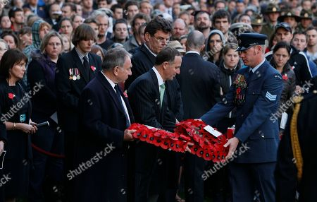 Stock Photo of John Key, John Dauth New Zealand's Prime Minister John Key, center with the Australian High Commissioner John Dauth, with wreaths at the New Zealand War Memorial, get prepare to lay them, at Hyde Park Corner in London,Monday, April, 25, 2011. April 25 is Anzac Day to commemorate the Australian and New Zealand Army Corps (ANZAC) who fought at Gallipoli in Turkey during World War I, and all those who fought and died for Austraila and New Zealand in conflicts around the world since then