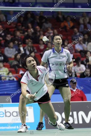 Chinese Taipei's Cheng Wen Hsing, right, Chien Yu Chin, left, return a shot to England's Jenny Wallwork and Gabrielle White during their women's doubles first round match at the All England Badminton Championships in the National Indoor Arena, Birmingham, England