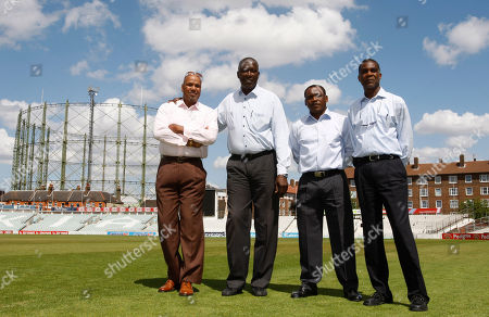 "West Indies cricketing legends Colin Croft, left, Joel Garner, second left, Gordon Greenidge, second right, and Michael Holding, right, are seen at the Oval cricket ground in London, ahead of the release of new film ""Fire in Babylon"", a feature documentary about the great West Indies cricket team of the 1970s and 80s"
