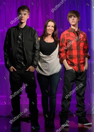 Justin Bieber, Pattie Malette Canadian musician Justin Bieber, left, stands alongside the new waxwork figure of himself with mom, Pattie, at Madame Tussauds in London