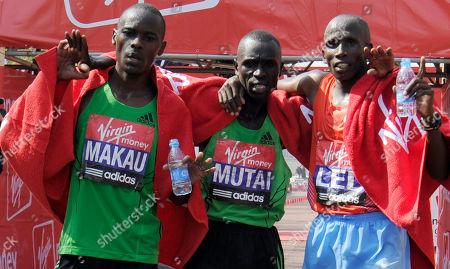 Emmanuel Mutai, Martin Lel, Patrick Makau Kenya's Emmanuel Mutai, centre, winner of the London Marathon, poses with fellow Kenyan runners, third placed Patrick Makau, left, and Martin Lel in second place, in London