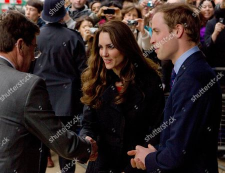 Prince William, Kate Middleton Britain's Prince William, right, watches, as his fiancee Kate Middleton shakes hands with New Zealand High Comissioner Derek Leask, as they depart New Zealand House in London, after signing a book of condolences for victims of the New Zealand earthquake