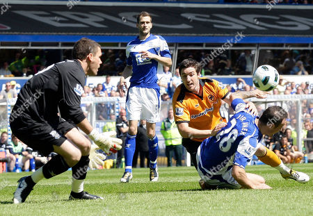 Birmingham City's Martin Jiranek, right, Roger Johnson, second left, and Ben Foster, left, compete for the ball with Wolverhampton Wanderers Stephen Ward during their English Premier League soccer match at St' Andrews stadium, Birmingham, England, . (AP Photo/Simon Dawson) NO INTERNET/MOBILE USAGE WITHOUT FOOTBALL ASSOCIATION PREMIER LEAGUE (FAPL) LICENCE. CALL +44