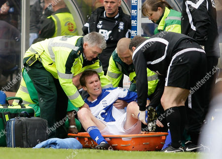Birmingham City's Alexander Hleb is put on a stretcher after getting injured during his teams English Premier League soccer match against Fulham at St' Andrews stadium, Birmingham, England, . (AP Photo/Simon Dawson)NO INTERNET/MOBILE USAGE WITHOUT FOOTBALL ASSOCIATION PREMIER LEAGUE (FAPL) LICENCE. CALL +44