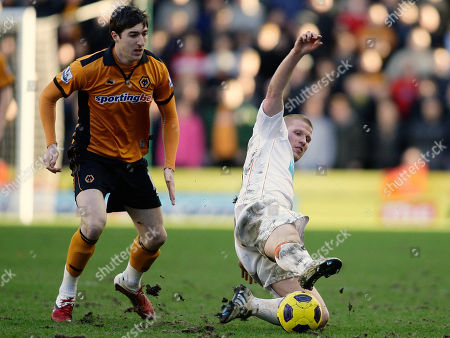 Blackpool's Keith Southern, right, competes for the ball with Wolverhampton Wanderers Stephen Ward during their English Premier League soccer match at the Molineux stadium, Wolverhampton, England, . (AP Photo/Simon Dawson) NO INTERNET/MOBILE USAGE WITHOUT FOOTBALL ASSOCIATION PREMIER LEAGUE (FAPL) LICENCE. CALL +44