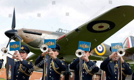 Segent Paul Sutton, left, Senior Aircraftman Michael McGowan, from Christchurch New Zealand, Senior Aircraftman Ben Godfrey, and Senior Aircraftman Andrew Lofthouse, right, members of the Fanfare Team of the Central Band of the Royal Air Force, pose in front of a replica of a World War II-era Hawker Hurricane fighter at a media event at RAF Northolt, London, Tuesday, April, 12, 2011. The fanfare team will play a specially composed piece at the wedding of Britain's Prince William and Kate Middleton inside London's Westminster Abbey during the service on April 29