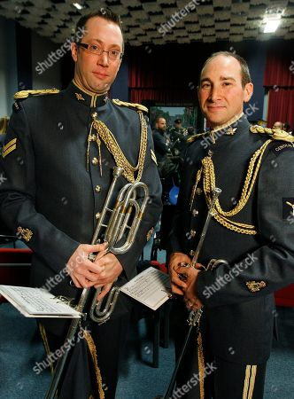Senior Aircraftman Michael McGowan, right, from Christchurch, New Zealand, with fellow countryman Corporal Hamish Dean, members of the Fanfare Team of the Central Band of the Royal Air Force, pose together at a media event at RAF Northolt, London, Tuesday, April, 12, 2011. The fanfare team will play a specially composed piece at the wedding of Britain's Prince William and Kate Middleton inside London's Westminster Abbey during the service on April 29