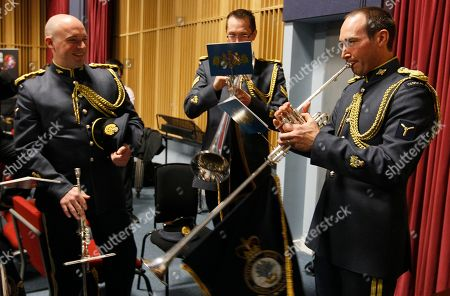 Senior Aircraftman Michael McGowan, right, from Christchurch, New Zealand, with fellow countryman Corporal Hamish Dean, at centre, members of the Fanfare Team of the Central Band of the Royal Air Force, pose together during a media event at RAF Northolt, London, Tuesday, April, 12, 2011. The fanfare team will play a specially composed piece at the wedding of Britain's Prince William and Kate Middleton inside London's Westminster Abbey during the service on April 29