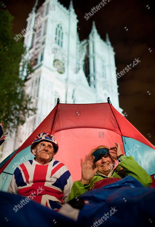 Terry Hutt, Jennifer Hawkins Royal fans Terry Hutt, left, and Jennifer Hawkins, right, sit in their tent in front of Westminster Abbey in London, late Tuesday night, . Revelers are camping out outside the Abbey where Prince William and Kate Middleton are due to get married on Friday, April 29
