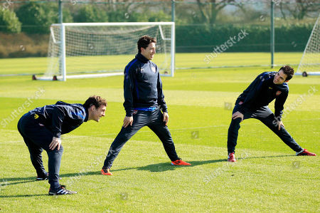 Arsenal's Cesc Fabregas, right, Samir Nasri, center, and Sebastien Squillaci take part in a training session at the club's facilities in London Colney, England, . Arsenal, leading 2-1 from the first leg, are due to play FC Barcelona in the second leg of their last-16 Champions League soccer match in Barcelona on Tuesday