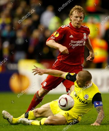 Tomas Repka, Dirk Kuyt Liverpool's Dirk Kuyt, top, vies for the ball against Sparta Prague's Tomas Repka during the second leg of their round of 32 Europa League soccer match at Anfield, Liverpool, England