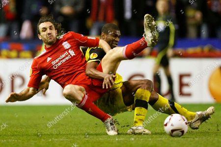 Leony Kweuke, Sotirios Kyrgiakos Liverpool's Sotirios Kyrgiakos, left, vies for the ball against Sparta Prague's Leony Kweuke during the second leg of their round of 32 Europa League soccer match at Anfield, Liverpool, England