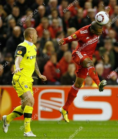 Stock Photo of Tomas Repka, David Ngog Liverpool's David Ngog, right, vies for the ball against Sparta Prague's Tomas Repka during the second leg of their round of 32 Europa League soccer match at Anfield, Liverpool, England
