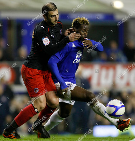 Louis Saha, Zurab Khizanishvili Everton's Louis Saha, right, vies for the ball against Reading's Zurab Khizanishvili during their FA Cup fifth round soccer match at Goodison Park, Liverpool, England, . (AP Photo/Tim Hales) NO INTERNET/MOBILE USAGE WITHOUT FOOTBALL ASSOCIATION PREMIER LEAGUE (FAPL) LICENCE. CALL +44