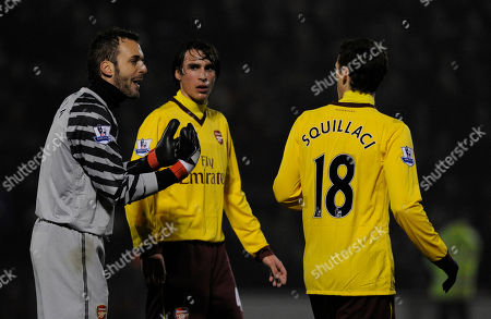 Manuel Almunia, Sebastien Squillaci, Ignasi Miquel Arsenal's Manuel Almunia, left, speaks to Sebastien Squillaci, right, and Ignasi Miquel, centre during their fifth round English FA Cup soccer match against Leyton Orient at the Brisbane Road stadium, London, . (AP Photo/Tom Hevezi) NO INTERNET/MOBILE USAGE WITHOUT FOOTBALL ASSOCIATION PREMIER LEAGUE(FAPL)LICENCE. CALL +44