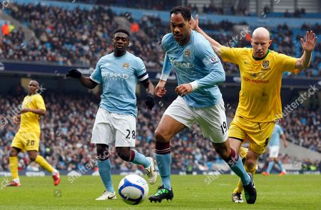 Joleon Lescott, Lee Hughes Manchester City's Joleon Lescott, second right, vies for the ball against Notts County's Lee Hughes, right, during their English FA Cup fourth round replay soccer match at the City of Manchester Stadium, Manchester, England, . (AP Photo/Tim Hales) NO INTERNET/MOBILE USAGE WITHOUT FOOTBALL ASSOCIATION PREMIER LEAGUE (FAPL) LICENCE. CALL +44