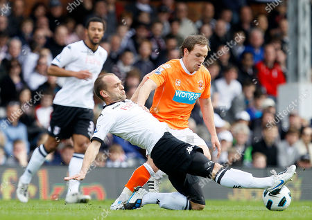 Fulham's Danny Murphy, left, goes for the ball with Blackpool's Elliot Grandin, during their English Premier League soccer match at Fulham's Craven Cottage stadium in London, Sunday, April, 3 2011 . (AP Photo/Alastair Grant) NO INTERNET/MOBILE USAGE WITHOUT FOOTBALL ASSOCIATION PREMIER LEAGUE(FAPL)LICENCE. CALL +44
