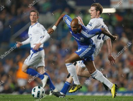 Chelsea's Nicolas Anelka, centre, goes for the ball with Birmingham City's Alexander Hleb during their English Premier League soccer match at Chelsea's Stamford Bridge stadium in London, Wednesday, April, 20 2011 . (AP Photo/Alastair Grant) NO INTERNET/MOBILE USAGE WITHOUT FOOTBALL ASSOCIATION PREMIER LEAGUE(FAPL)LICENCE. CALL +44