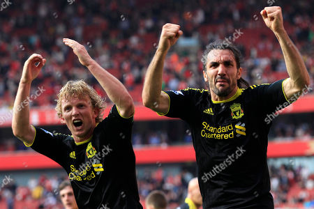 Dirk Kuyt, Sotirios Kyrgiakos Liverpool's Dirk Kuyt, left, celebrates his penalty goal against Arsenal with teammate Sotirios Kyrgiakos during their English Premier League soccer match at Emirates Stadium, London, . (AP Photo/Sang Tan) NO INTERNET/MOBILE USAGE WITHOUT FOOTBALL ASSOCIATION PREMIER LEAGUE (FAPL) LICENCE - CALL +44