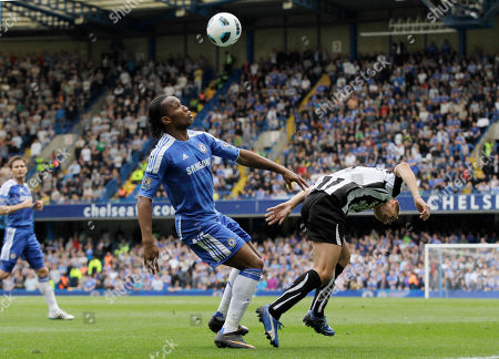 Didier Drogba, Peter Lovenkrands Chelsea's Didier Drogba, left, competes with Newcastle United's Peter Lovenkrands during their English Premier League soccer match at Stamford Bridge, London, . (AP Photo/Sang Tan) NO INTERNET/MOBILE USAGE WITHOUT FOOTBALL ASSOCIATION PREMIER LEAGUE (FAPL) LICENCE - CALL +44