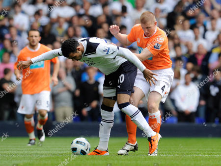 Sandro, Keith Southern Tottenham Hotspur's Sandro, left, is challenged by Blackpool's Keith Southern during their English Premier League soccer match at the White Hart Lane stadium, London, . (AP Photo/Tom Hevezi) NO INTERNET/MOBILE USAGE WITHOUT FOOTBALL ASSOCIATION PREMIER LEAGUE(FAPL)LICENCE. CALL +44