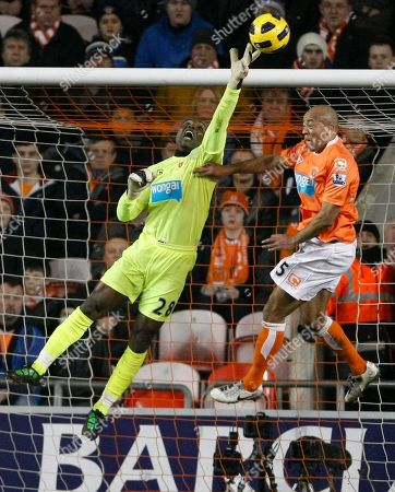 Richard Kingson, Alex Baptiste Blackpool goalkeeper Richard Kingson, left, makes a save as team mate Alex Baptiste looks on against Tottenham Hotspur during their English Premier League soccer match at Bloomfield Road, Blackpool, England, . (AP Photo/Tim Hales) NO INTERNET/MOBILE USAGE WITHOUT FOOTBALL ASSOCIATION PREMIER LEAGUE (FAPL) LICENCE. CALL +44