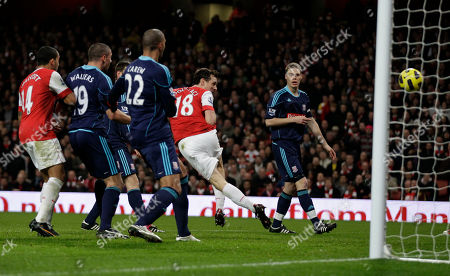 Arsenal's Sebastien Squillaci, second right, scores a goal during the English Premier League soccer match between Arsenal and Stoke City at the Emirates Stadium in London, . (AP Photo/Matt Dunham) NO INTERNET/MOBILE USAGE WITHOUT FOOTBALL ASSOCIATION PREMIER LEAGUE(FAPL)LICENCE. CALL +44