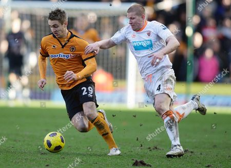 Blackpool's Keith Southern, right, competes for the ball with Wolverhampton Wanderers' Kevin Doyle during their English Premier League soccer match at the Molineux stadium, Wolverhampton England. . (AP Photo/Simon Dawson) NO INTERNET/MOBILE USAGE WITHOUT FOOTBALL ASSOCIATION PREMIER LEAGUE (FAPL) LICENCE. CALL +44