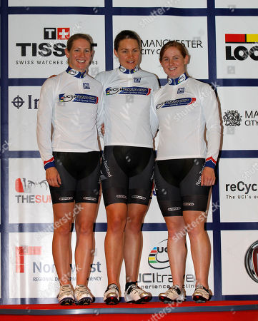 New Zealand's Alison Shanks, left, Lauren Ellis, center, and Jaime Nielsen pose after their overall World Cup victory in the Women's Team Pursuit competition despite finishing second during the Track Cycling World Cup at the National Cycling Centre, Manchester, England