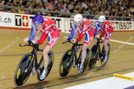 Britain's Sarah Storey, left, leads teammates Wendy Houvenaghel, center, and Joanna Roswell around the track on their way to victory in the Women's Team Pursuit competition during the Track Cycling World Cup at the National Cycling Centre, Manchester, England
