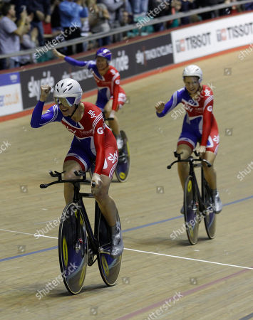 Britain's Joanna Roswell, left, celebrates with teammates Wendy Houvenaghel, right, and Sarah Storey after winning the Women's Team Pursuit competition during the Track Cycling World Cup at the National Cycling Centre, Manchester, England