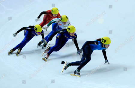 Gold medal winner Katherine Reutter, right, from the U.S., silver medal winner South Korea's Park Seung-Hi, second right, and bronze winner South Korea's Ha-Ri Cho, left, compete in the final of the women's 1500 meter race at the World Short Track Speed Skating Championships at the Motorpoint arena in Sheffield, England, . The event runs from Friday March 11 until Sunday March 13