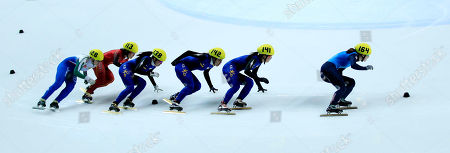 Gold medal winner Katherine Reutter, right, from the U.S., silver medal winner South Korea's Park Seung-Hi, second right, and bronze winner South Korea's Ha-Ri Cho, fourth right, compete in the final of the women's 1500 meter race at the World Short Track Speed Skating Championships at the Motorpoint arena in Sheffield, England, . The event runs from Friday March 11 until Sunday March 13