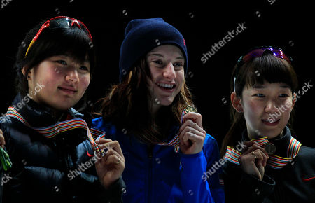 Gold medalist in the women's 1500 meter race Katherine Reutter, center, of the U.S. poses for photographs with silver medalist South Korea's Park Seung-Hi, left, and bronze medalist Cho Ha-Ri at the World Short Track Speed Skating Championships at the Motorpoint arena in Sheffield, England, . The event runs from Friday March 11 until Sunday March 13