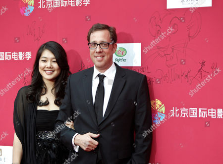 Stock Photo of Rob Minkoff, Crystal Kung Minkoff American film director Rob Minkoff, right, and his wife Crystal Kung Minkoff pose for photo upon their arrival at the opening of the Beijing International Film Festival in Beijing, China