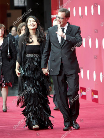 Stock Image of Rob Minkoff, Crystal Kung Minkoff American film director Rob Minkoff, right, walks with his wife Crystal Kung Minkoff upon their arrival at the opening of the Beijing International Film Festival in Beijing, China