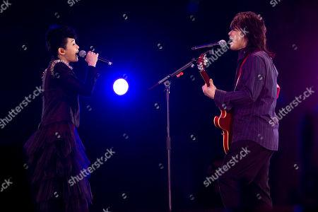 Wu Bai, Rene Liu Taiwanese rock star Wu Bai, right, performs with Taiwanese actress-singer Rene Liu, left, during Rock Records' 30th Anniversary Beijing Concert in China's National Stadium, also known as the bird's nest, in Beijing, China