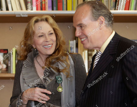 Faye Dunaway, Frederic Mitterand Actress Faye Dunaway, left, speaks with French Minister for Culture Frederic Mitterrand after receiving the Legion of Honour medal at the 64th international film festival, in Cannes, southern France