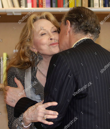 Faye Dunaway, Frederic Mitterand Actress Faye Dunaway, left, embraces French Minister for Culture Frederic Mitterrand after receiving the Legion of Honour medal at the 64th international film festival, in Cannes, southern France
