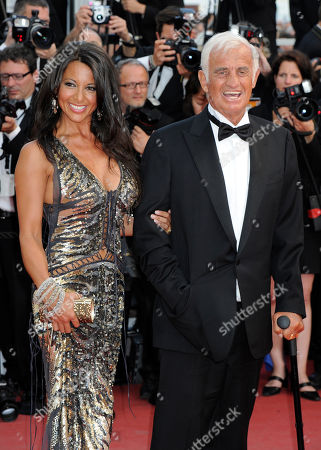 Barbara Gandolfi, Jean-Paul Belmondo Jean-Paul Belmondo, right, arrives with Barbara Gandolfi to the ceremony celebrating his career in the film industry during the 64th international film festival, in Cannes, southern France