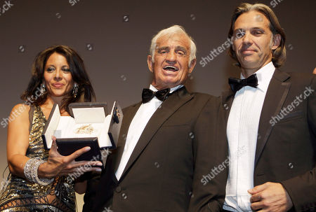 Barbara Gandolfi, Paul Belmondo, Jean-Paul Belmondo Actor Jean-Paul Belmondo, centre, poses with his son Paul Belmondo, right, and Barbara Gandolfi, left, at the ceremony celebrating his career in the film industry during the 64th international film festival, in Cannes, southern France