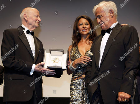 Barbara Gandolfi, Jean-Paul Belmondo, Gilles Jacob Barbara Gandolfi, left, stands next to actor Jean-Paul Belmondo, right, while he receives an award celebrating his career in the film industry from the President of the festival Gilles Jacob, left, during the 64th international film festival, in Cannes, southern France