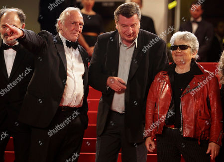 Aki Kaurismaki, Little Bob, Blondin Miguel From left, actor Blondin Miguel, director Aki Kaurismaki and actor Little Bob arrive for the screening of Le Havre at the 64th international film festival, in Cannes, southern France