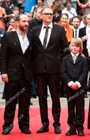 Michael Fuith, Markus Schleinzer, David Rauchenberger Director Markus Schleinzer, center, arrives with actors Michael Fuith, left, and David Rauchenberger, right, for the screening of Michael, at the 64th international film festival, in Cannes, southern France