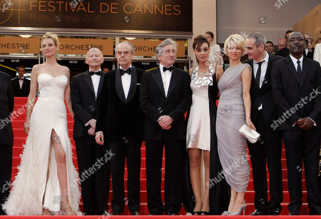 Uma Thurman, Gilles Jacob, Frederic Mitterand, Robert De Niro, Martina Gusman, Linn Ullmann, Olivier Assayas, Mahamat Saleh Haroun From left, jury member Uma Thurman, president of the festival Gilles Jacob, French Culture Minister Frederic Mitterrand, president of the jury Robert De Niro, jury members Martina Gusman, Linn Ullmann, Olivier Assayas, and Mahamat Saleh Haroun arrive for the screening of Midnight in Paris and the opening ceremony, at the 64th international film festival, in Cannes, southern France