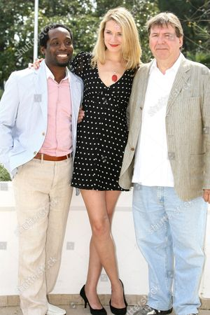 """Stock Image of Canadian actress Natalie Lisinska, Canadian actor Remy Girard, right, and Canadian actor Richard Yearwood pose for photographers during the MIPTV (International Television Programme Market), in Cannes, southern France. They present """"InSecurity"""" a new action packed, comedy spy series about agent Alex Cranston and her team of espionage misfits from the fictional National Intelligence and Security Agency (NISA"""